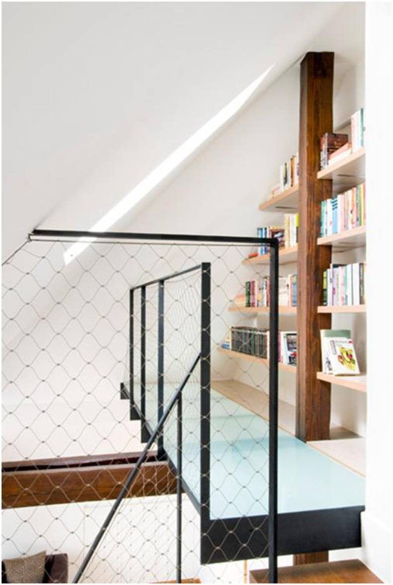 Compact bookshelves built into the staircase