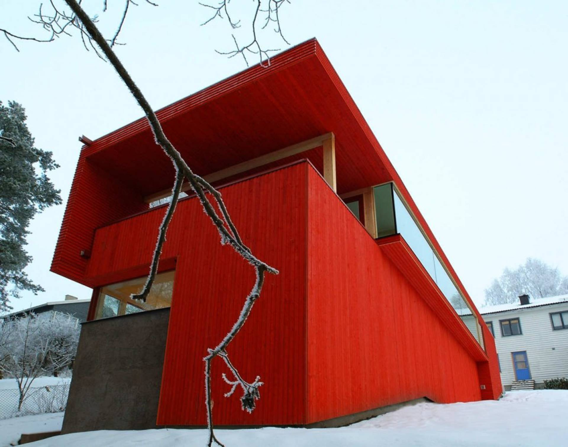 Wooden House with Red Facade by JVA Architects ...